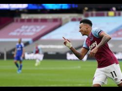 West Ham's Jesse Lingard celebrates after scoring his side's second goal during the English Premier League match against Leicester City at the London Stadium in England yesterday.