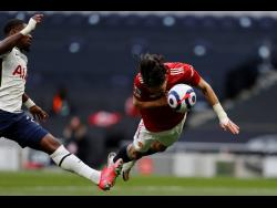 Manchester United's Edinson Cavani in action during the English Premier League match against Tottenham Hotspur at the Tottenham Hotspur Stadium in London yesterday.