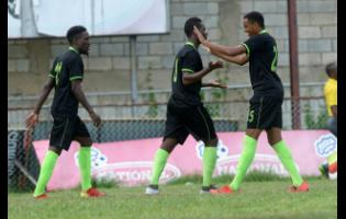 Tyrique Wilson (centre) of Molynes United FC celebrates with teammate Orane Ferguason (right) after scoring against Arnett Gardens FC during their RSPL encounter at Drewsland on September 22, 2019.