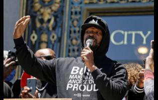 "Jamie Foxx speaks to a large crowd during a ""kneel-in"" to protest police racism on the steps of City Hall in San Francisco, California, yesterday."