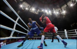 Cristian Salcedo of Colombia (right) throws a punch to Ricardo Brown of Jamaica during the second round of their men's heavy 91kg semi-final boxing match at the Pan American Games in Lima, Peru, in July 2019.