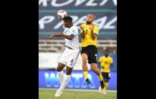 Kemar Roofe (right) in action for Jamaica against Panama's Fidel Escobar Mendieta during their Concacaf World Cup qualification match at the National Stadium on Sunday, September 5.